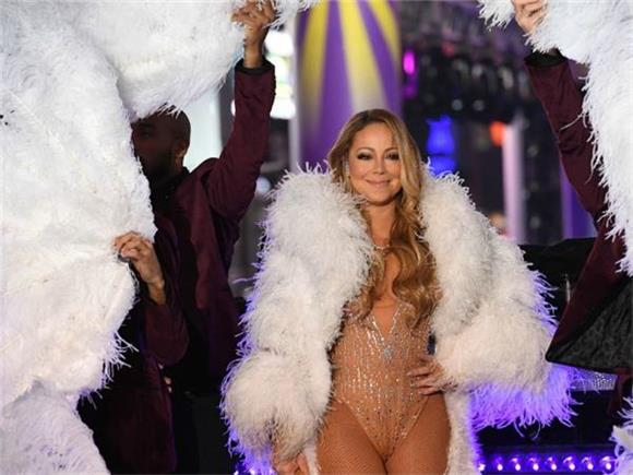 Let's Compare and Contrast All of Mariah Carey's Memorable Holiday Performances