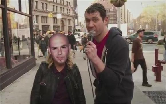 Watch Amy Poehler Creep On New Yorkers In a Pitbull Mask