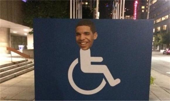 Gluing Drake's Face to Handicapped Signs Is a Thing Now