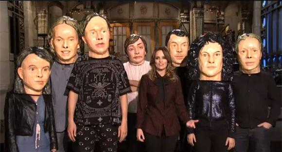 Arcade Fire Masks Up For SNL Promos With Tina Fey