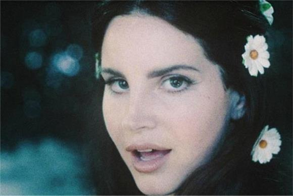 Watch Lana Del Rey Share a New Song While Sitting In The Woods