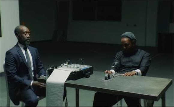 Watch Kendrick Lamar Go Head To Head With Don Cheadle in Video For 'DNA.'